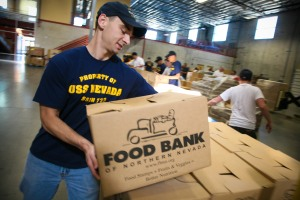 090916-N-3271W-031 MCCARRAN, Nev. (Sept. 16, 2009) ElectricianÕs Mate 1st Class Kevin Garber, assigned to the Ohio-class fleet ballistic-missile submarine USS Nevada (SSBN-733) moves food boxes for needy families at the Food Bank of Northern Nevada during Reno Navy Week. Navy Weeks are designed to show Americans the investment they have made in their Navy and increase awareness in cities that do not have a significant Navy presence. (U.S. Navy photo by Senior Chief Mass Communication Specialist Gary Ward/Released)